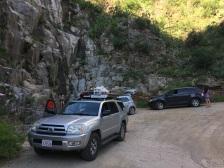 The caravan of vehicles.